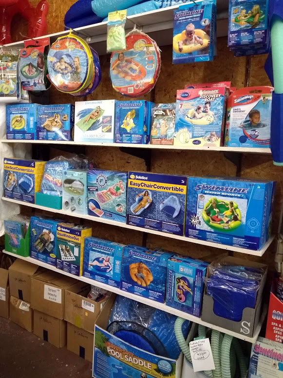 large selection of pool toys